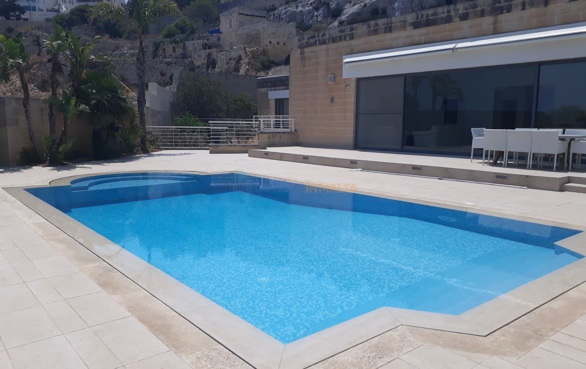 Luxury villa malta with views and pool area letting in for Luxury pool area